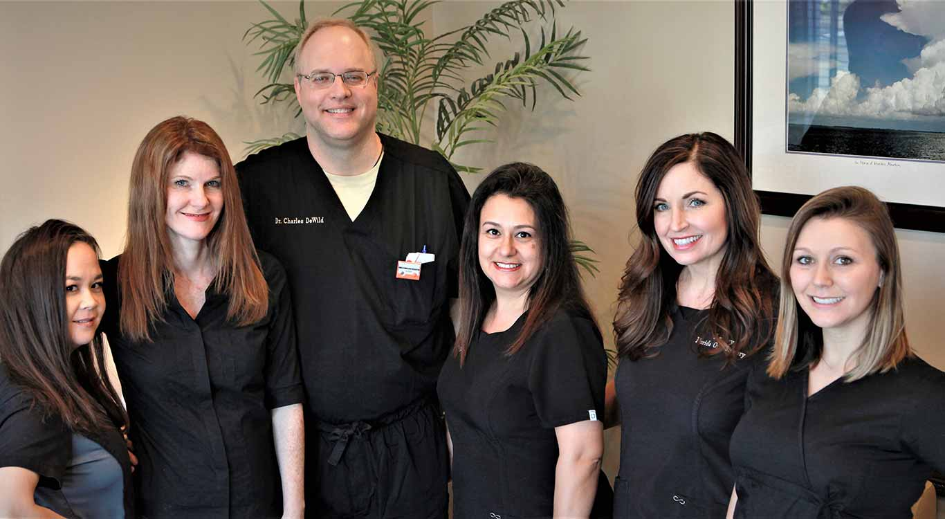 group image of the team at florida oral surgery